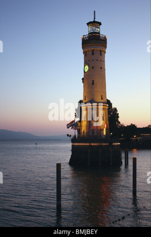 Lindau (Bodensee) Lighthouse and marina on Lake Constance in Germany at sunset - Stock Photo