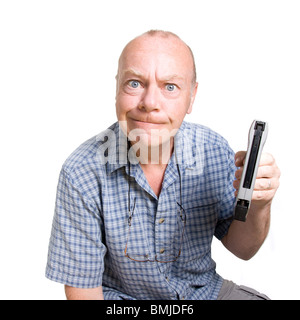 Expressive old man looking aggressive isolated against white background. - Stock Photo