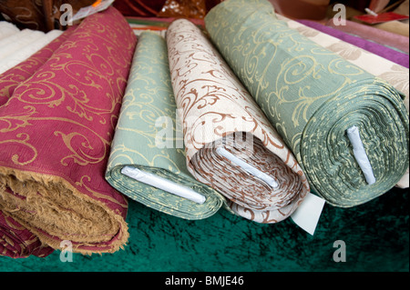 Patterned fabrics for sale at Turkish market on Maybachufer in Kreuzberg district of Berlin Germany - Stock Photo