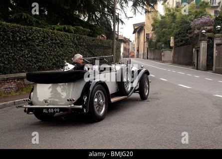 Classic Mercedes car departing Villa D'Este Como Italy - Stock Photo