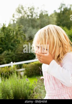 Little girl standing in garden