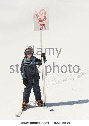 Boy skier holding Santa sign - Stock Photo