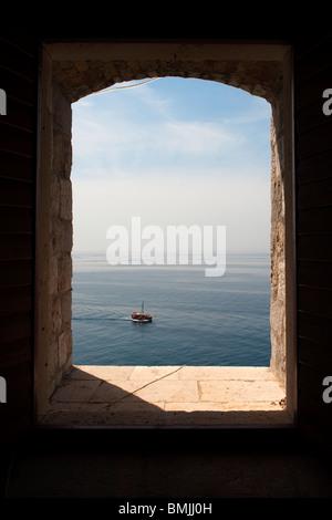 View of the Adriatic Sea, through a portal in the Lovrijenac Fortress, Dubrovnik, Croatia, Europe - Stock Photo
