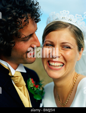 Scandinavia, Sweden, Oland, Groom looking at bride smiling, close-up - Stock Photo