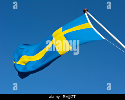 Scandinavia, Sweden, Stockholm, Swedish flag against sky, close-up - Stock Photo