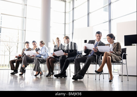 Group of business people with chairs - Stock Photo