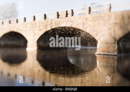 Scandinavian Peninsula, Sweden, Skane, View of arch bridge over river - Stock Photo