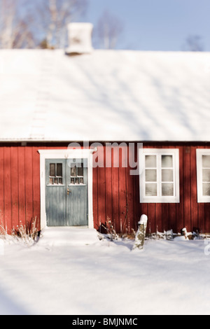 Scandinavian Peninsula, Sweden, Skane, View of house covered with snow - Stock Photo