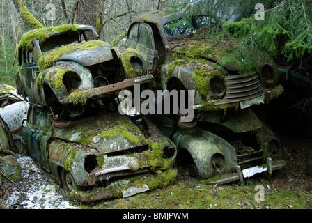 Scandinavia, Sweden, Varmland, View of abandoned car - Stock Photo