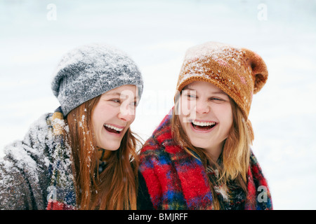 Two happy young women in snow - Stock Photo