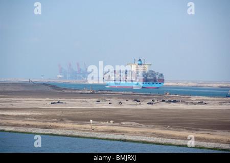 Egypt, Suez Canal. Cargo ship transiting canal. - Stock Photo