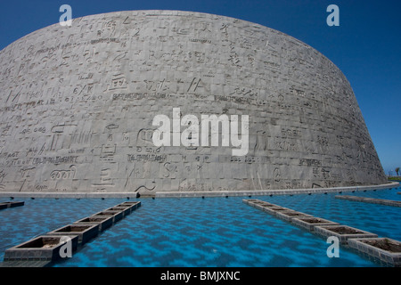 Pool and hand-carved granite wall with stones of the Bibliotheca Alexandrina, the modern Library of Alexandria, - Stock Photo