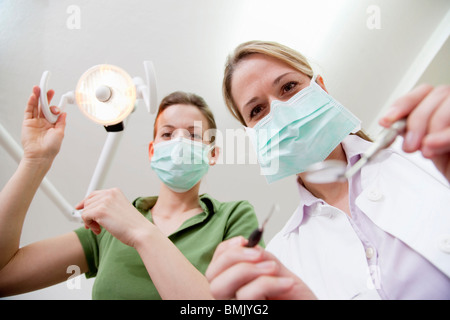 Dentist and dental technician in surgery - Stock Photo