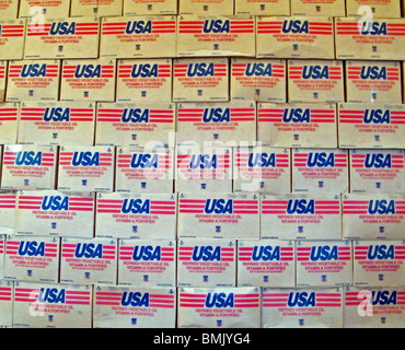 Stacks of vegetable oil donated by the USA lie in a World Food Program warehouse in Gonaives, Haiti - Stock Photo
