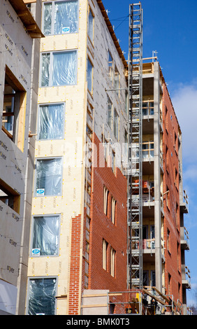 Partially finished outer wall brick laying and insulation on a Finnish block of flats , Finland - Stock Photo
