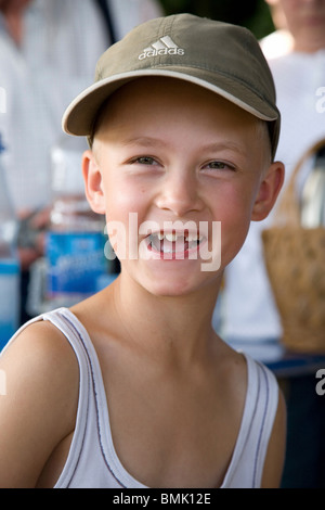 Portrait of a young boy in peaked cap - Stock Photo