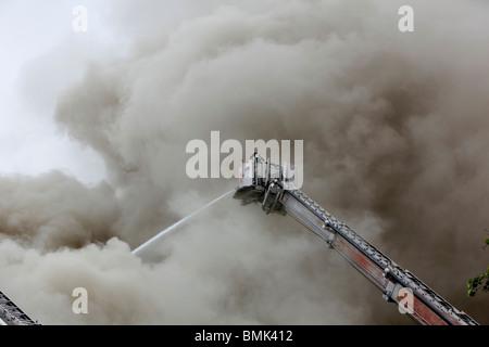 firefighter battling a smoky blaze