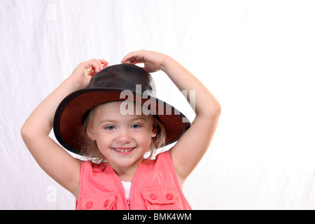 Young cowgirl in a cowboy hat - Stock Photo