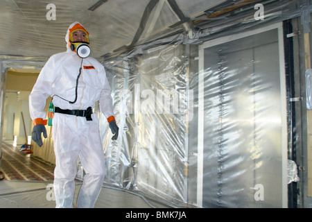 Worker specialized in asbestos removal - Stock Photo
