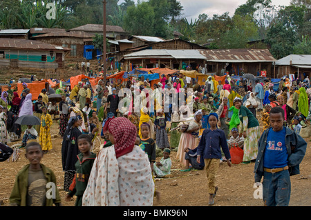 Colorfully dressed people in open-air market in a small village on the road between Addis Ababa and Jima, Ethiopia. - Stock Photo