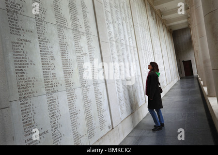 A visitor takes a look at some of the 54,896 names on the Menin Gate Memorial at Ypres, Belgium. - Stock Photo