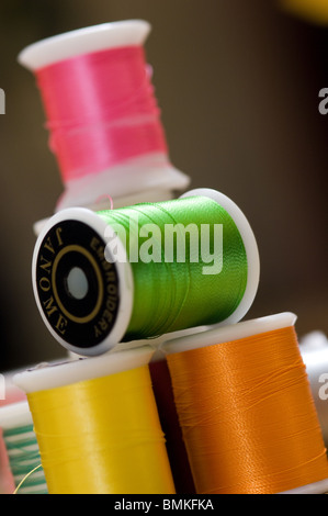 Rolls of brightly coloured cotton thread. - Stock Photo