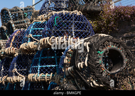 UK, England, Devon, Brixham fishing Industry lobster pots on the quayside - Stock Photo