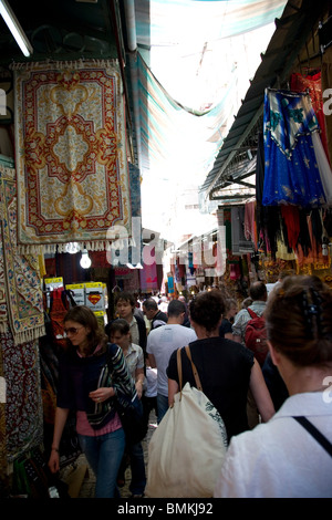 Market in Jerusalem Old City with tourists - Stock Photo