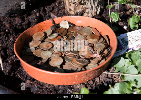 A pot of dirty and rusty English coins, mostly two and one pence pieces - Stock Photo