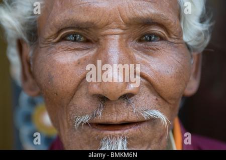 Old Buddhist monk. Chimi Lhakhang. Bhutan. Asia. - Stock Photo