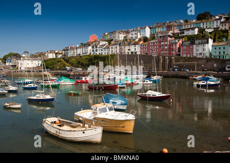 UK, England, Devon, Brixham leisure boats moored in the harbour below attractive seafront houses - Stock Photo
