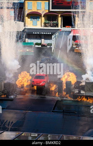 Red car jumps through flaming explosions at end of show in 'Lights, Motors, Action! Extreme Stunt Show' at Hollywood - Stock Photo