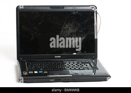 broken laptop computer with cracked screen - Stock Photo