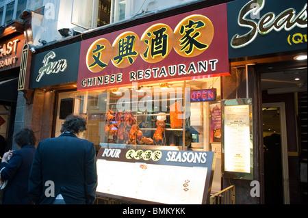 London, UK, Chinatown, Couple Reading Menus Outside Chinese Restaurant 'Four Seasons' - Stock Photo