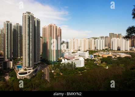 High apartment buildings densely packed together, forming 'wall blocks' on the mountain side, providing shelter - Stock Photo