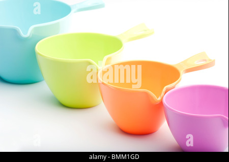 Close-up Of Four Plastic Measuring Cups - Stock Photo