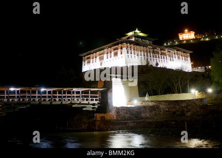 Buddhistic monastery at night, Paro, Bhutan, Asia - Stock Photo