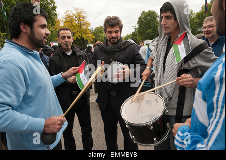 Young Muslim men with drums and instruments at Al Quds Day (Jerusalem Day) march in London - Stock Photo