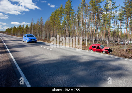 Crashed Volkswagen Golf at roadside ditch , Finland - Stock Photo