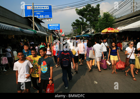 Shoppers in Chatuchak weekend market, Bangkok, Thailand - Stock Photo