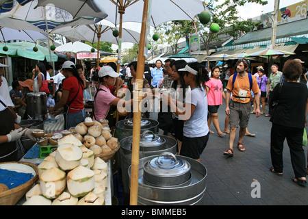 coconut ice cream stall at Chatuchak weekend market, Bangkok - Stock Photo