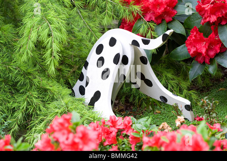 decorative wooden dalmatian dog in garden - Stock Photo