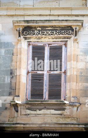 A shuttered window in Malta - Stock Photo
