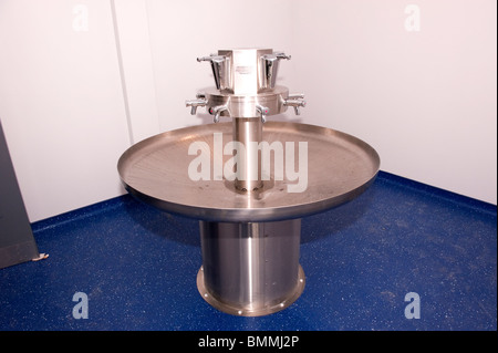 Stainless steel circular hand wash sink in factory - Stock Photo