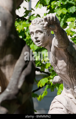 Statue guarding the entrance of the Mirabell gardens in Salzburg, Austria. - Stock Photo