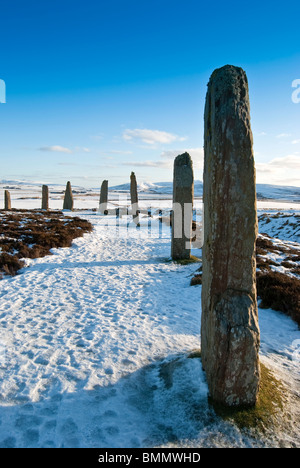 Ring of Brodgar in Winter, blue sky over snowy ground - Stock Photo