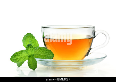 tea in glass cup with green mint - Stock Photo