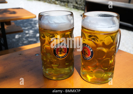 two litre masskrugs of Paulaner helles bier, Munich, Germany - Stock Photo