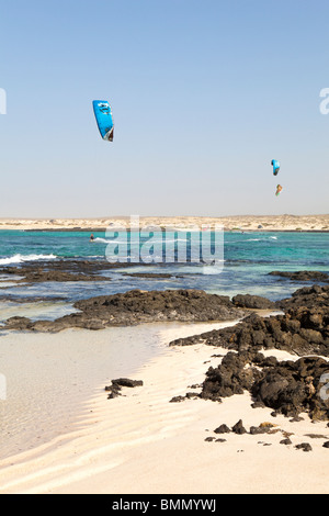 Kitesurfing at El Cotillo on the Canary island of Fuerteventura - Stock Photo