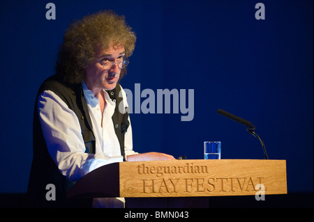Brian May Queen guitarist & badger campaigner pictured speaking at lectern during Hay Festival 2010 Hay on Wye Powys - Stock Photo